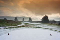 Tee on a snowy golf course Royalty Free Stock Image