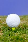 'Tee time'. Golf ball on tee with sky in background Royalty Free Stock Photography