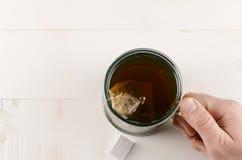 Tee und Daumen Lizenzfreies Stockfoto
