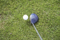 Tee-up the golf ball 01. Driving the golf ball with the driver Royalty Free Stock Photo