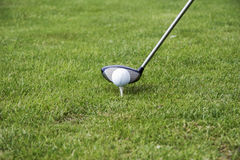 Tee-up the golf ball 02. Driving the golf ball with the driver Royalty Free Stock Image