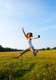 Teeage Girls Outdoors Jumping Stock Photography
