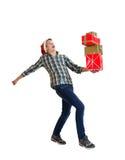 Teeager en el sombrero de Papá Noel con un regalo Fotos de archivo