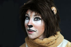 Teeanager actress. Young actress in a costume of a lion likes to play  in an amateur actors group Stock Photo