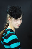 Teeanager girl with pillbox hat Royalty Free Stock Photography