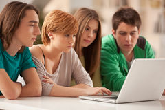 Teeangers Watching Something on a Laptop Stock Image