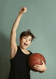 Teeb boy with basketball ball score goal gesture Stock Images