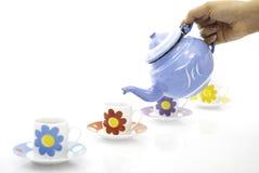Teecup und -kessel Stockfoto