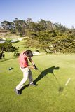 Teeing off. A young man tees off (motion blur Stock Photos