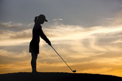 Teeing up at sunset. Royalty Free Stock Photography