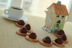 Kaffee mit Süßigkeiten Stockbilder
