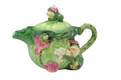 Teekanne mit Fröschen Stockfotografie