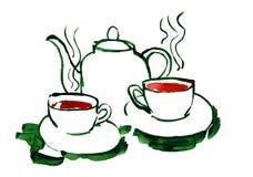 Teekanne und Gläser mit Tee stockfotos