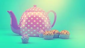 Teekanne und kleine Kuchen Stockfotos