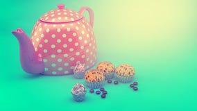 Teekanne und kleine Kuchen Stockbild
