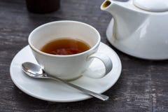 Teekanne und Teetasse Lizenzfreie Stockfotos