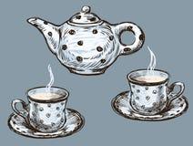 Teekanne und Teetassen Stockfotografie