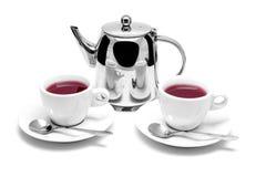 Teekanne und zwei Tassen Tee auf einer Untertasse Stockbild