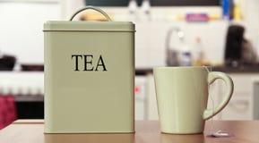 Teekasten und -cup Stockfoto