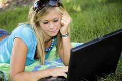 Teen. Model Release 358 Teenage girl working on laptop computer outdoors stock photography