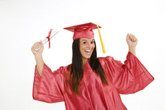 Beautiful Caucasian woman wearing a red graduation gown holding diploma Royalty Free Stock Photos