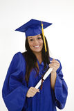 Beautiful Caucasian woman wearing a blue graduation gown holding diploma Royalty Free Stock Photo