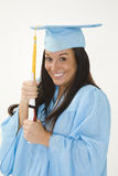 Beautiful Caucasian woman wearing a blue graduation gown holding diploma Stock Image