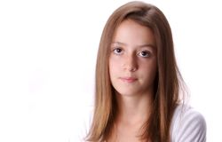 Teen. Young teen against white background with serious or sullen expression Stock Image