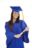 Beautiful Caucasian woman wearing a blue graduation gown holding diploma Stock Photos