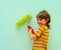 Teen. With Roller Against The Light Green Wall Royalty Free Stock Photos