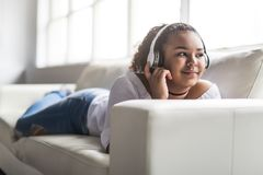 Teen african young woman relaxing at home Stock Photography