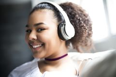 Teen african young woman relaxing at home Royalty Free Stock Photos