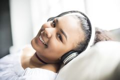 Teen african young woman relaxing at home. A teen african young woman relaxing at home Royalty Free Stock Photo