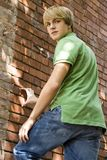 Teen Agaist Brick Wall stock image