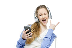 Teen age girl with headphones Royalty Free Stock Images