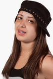 Teen ager wearing hat. Young pretty hispanic girl wearing in black hat with braces smiling royalty free stock image