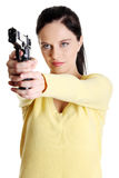 Teen aiming girl. Pretty caucasian teen aiming girl with gun. Isolated on white Royalty Free Stock Photo