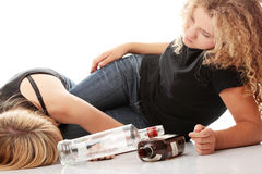 Teen alcohol addiction. (drunk teens with vodka and whisky bottle Stock Photo