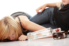 Teen alcohol addiction. (drunk teens with vodka and whisky bottle Royalty Free Stock Photos