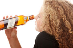 Teen alcohol addiction. (drunk teens with vodka and whisky bottle Royalty Free Stock Image