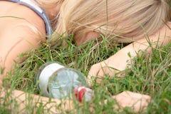Teen alcohol addiction. (drunk teen with vodka bottle Stock Photo