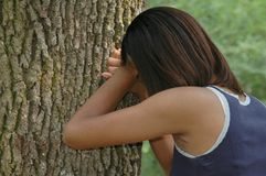 Teen Alone. African american teen in a state of depression Stock Photos