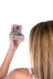 Teen applying eye makeup in mirror Royalty Free Stock Photos