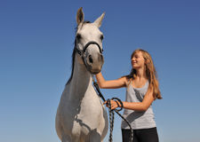Teen and arabian horse Stock Photos