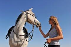 Teen and arabian horse stock image