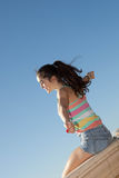 Teen arms outstretched for vacation freedom Stock Image