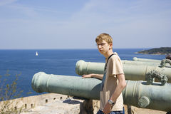 Teen as a gunner or as cannon fodder. Citadel of saint-tropez, french riviera, mediterranean sea - adobe RGB Stock Photos