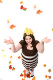 Teen as seen from above with fall leaves Royalty Free Stock Photo