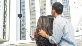 Teen asia people use smart phone to selfie, self-portrait photog. Raphy shoot, held in the hand and supported by a selfie stick Royalty Free Stock Photos