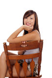 Teen Asian Girl Sitting On Chair Smiling Royalty Free Stock Photography